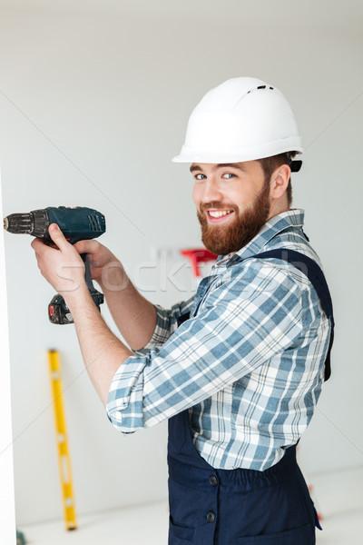 Joven perforación reparación jóvenes barbado Foto stock © deandrobot