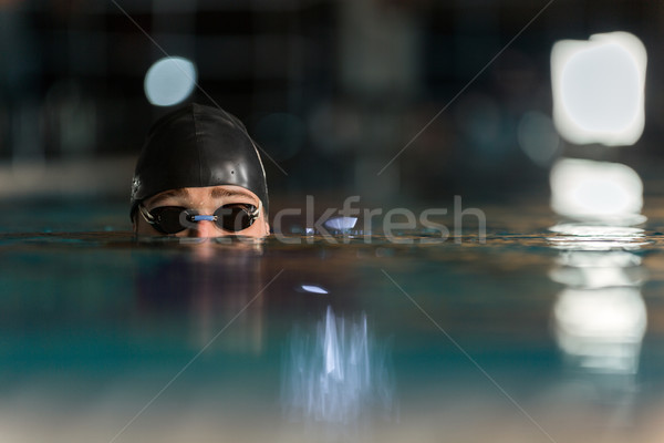 Close up of the top of a male swimmers head Stock photo © deandrobot