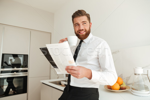 Happy bearded business man drinking coffee Stock photo © deandrobot