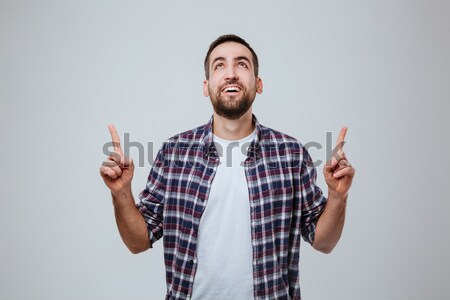 Happy screaming bearded man showing thumbs up Stock photo © deandrobot