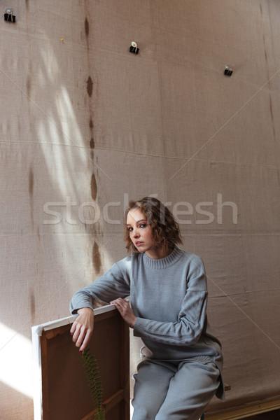 Donna seduta sedia tela Foto d'archivio © deandrobot