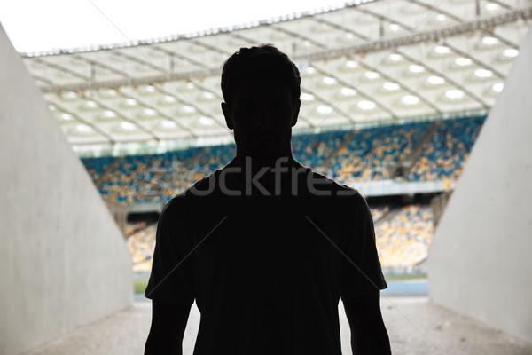 Silueta hombre pie estadio entrada deporte Foto stock © deandrobot