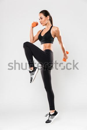 Full length portrait of a healthy young asian fitness woman Stock photo © deandrobot