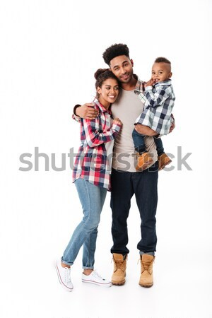 Full length portrait of a cheerful young african family Stock photo © deandrobot
