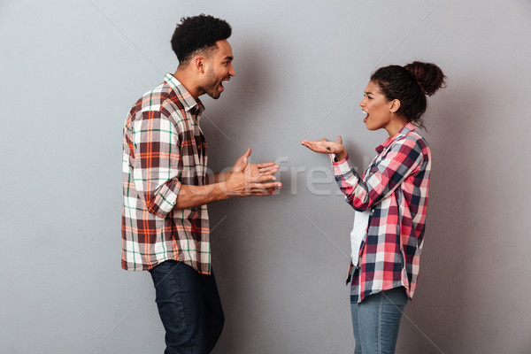 Portrait of a furious young african couple having a quarrel Stock photo © deandrobot