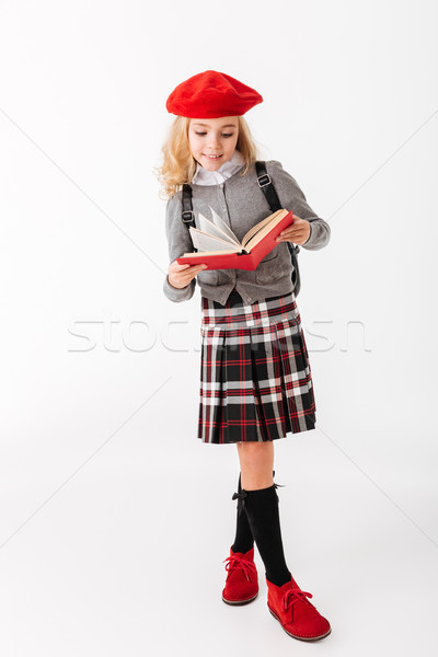Full length portrait of a happy little schoolgirl Stock photo © deandrobot