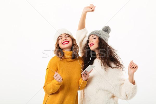Kettő elégedett lányok sapkák tánc együtt Stock fotó © deandrobot