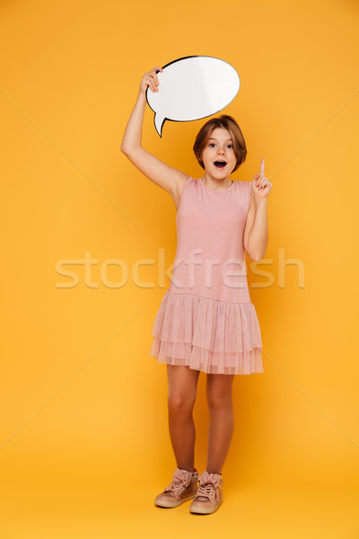 Full-length shot of happy confident girl holding bubble speech and have an idea Stock photo © deandrobot
