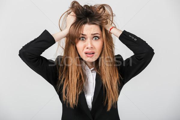Portret onzeker zakenvrouw pak haren Stockfoto © deandrobot