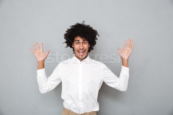 Portré fiatal afrikai férfi kéz a kézben kiemelt Stock fotó © deandrobot