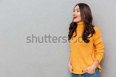 Confused brunette woman in sweater looking away while having cold Stock photo © deandrobot