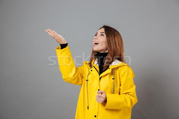 Portré izgatott lány esőkabát gumicsizma pózol Stock fotó © deandrobot