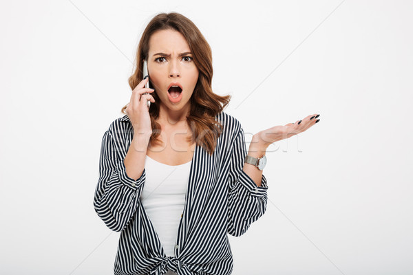 Portrait of a frustrated casual girl Stock photo © deandrobot