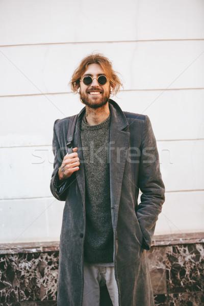 Portrait of a happy bearded man Stock photo © deandrobot