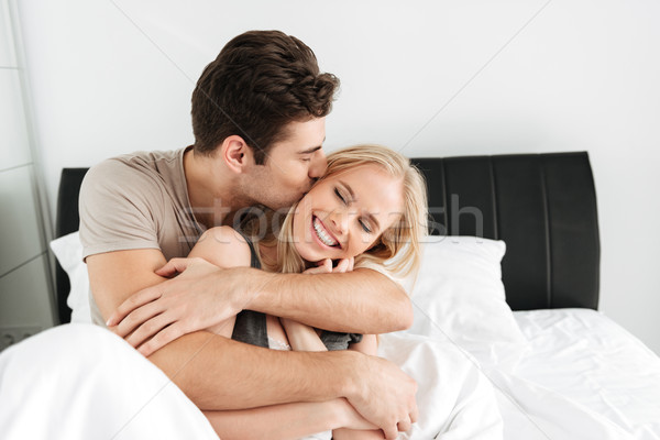 Young pretty man kissing and hugging his happy wife Stock photo © deandrobot