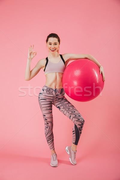 Teljes alakos kép boldog sportoló pózol fitnessz Stock fotó © deandrobot