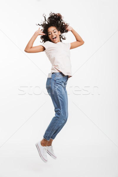 Full length image of attractive african american woman with brow Stock photo © deandrobot