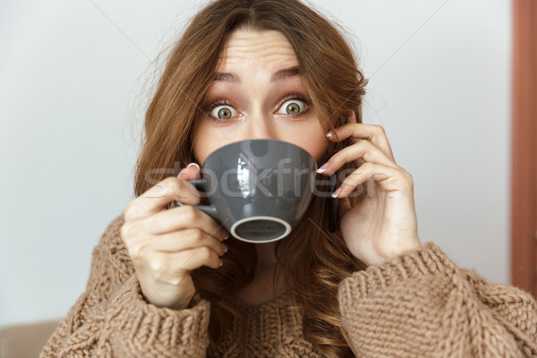 Photo of cheerful young woman 20s looking on camera with excitin Stock photo © deandrobot