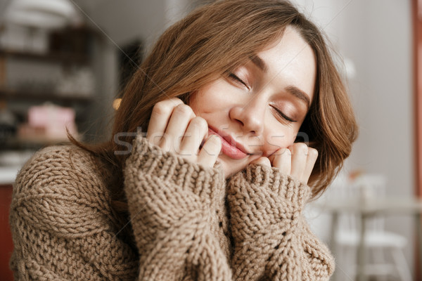 Portrait closeup of attractive woman in knitted sweater, sitting Stock photo © deandrobot