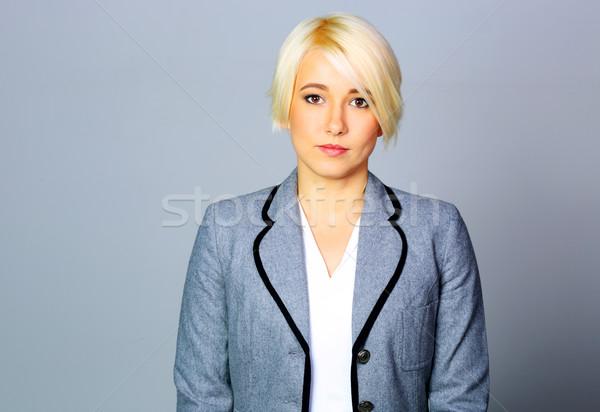 Kobieta interesu szary kurtka stałego działalności kobieta Zdjęcia stock © deandrobot