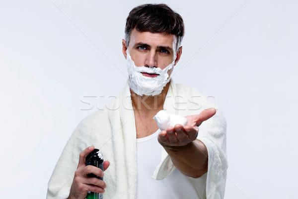 человека кремом серый стороны лице человек Сток-фото © deandrobot