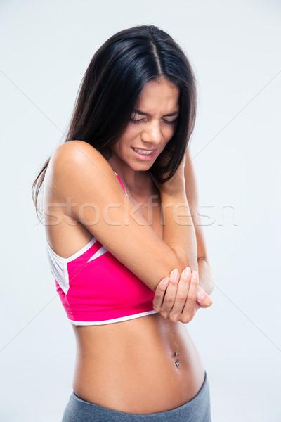 Fitnessz nő könyök fájdalom szürke lány sport Stock fotó © deandrobot