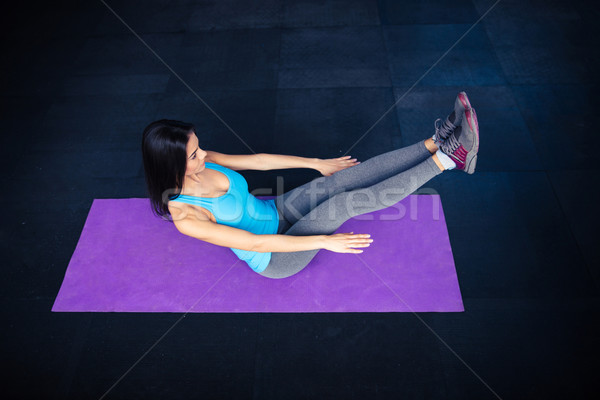 Woman doing excercise on yoga mat  Stock photo © deandrobot