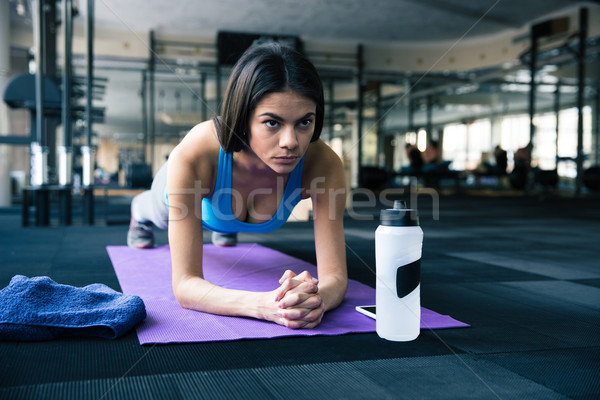 Beautiful fit woman working out on yoga mat Stock photo © deandrobot