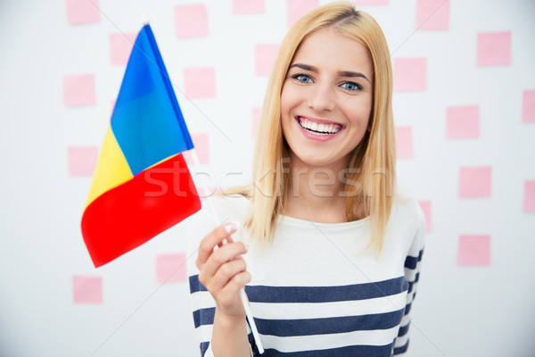 Happy woman holding Romanian flag Stock photo © deandrobot