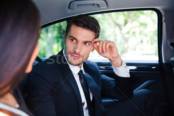 Business couple talking in car Stock photo © deandrobot