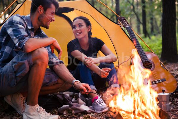 Portrait of a happy couple and bonfire  Stock photo © deandrobot