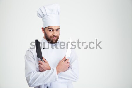 Happy male chef cook sharpening knife Stock photo © deandrobot