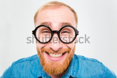 Suspicious bearded man in funny round glasses pointing on you Stock photo © deandrobot