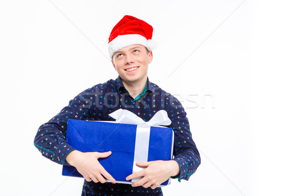 Excited anticipated male in santa claus hat holding gift  Stock photo © deandrobot