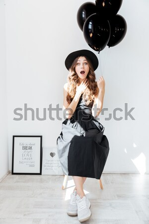 Charming joyful young female laughing and holding vinyl record  Stock photo © deandrobot