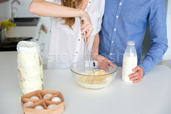 Closeup of dough made by young couple in glass bowl Stock photo © deandrobot