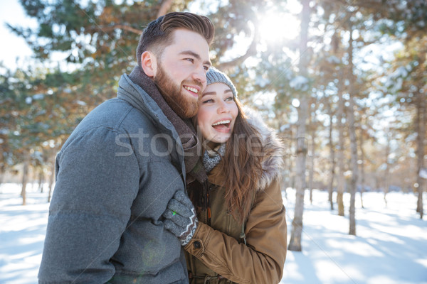 Cheerful couple standing in winter park  Stock photo © deandrobot