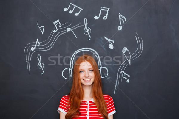 Gyönyörű nő zenét hallgat fülhallgató rajzolt tábla gyönyörű Stock fotó © deandrobot