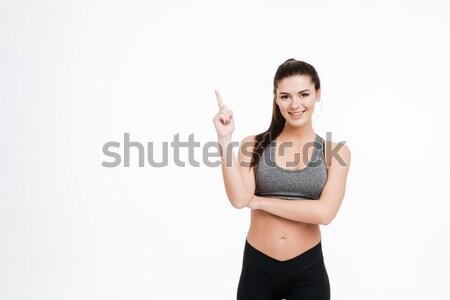 Derűs gyönyörű fiatal nő sötét hosszú haj áll Stock fotó © deandrobot