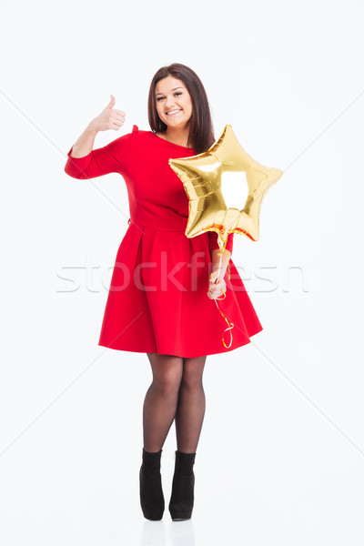 Happy woman holding balloon and showing thumb up  Stock photo © deandrobot