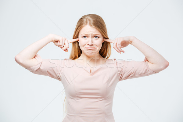 Sad woman covering her ears  Stock photo © deandrobot