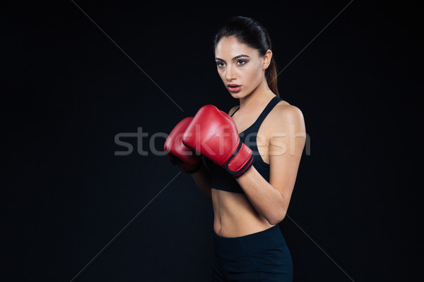 Fitness woman standing in boxing gloves Stock photo © deandrobot