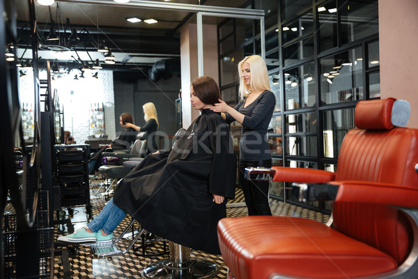 Young girl talking with hairdresser in beauty salon Stock photo © deandrobot