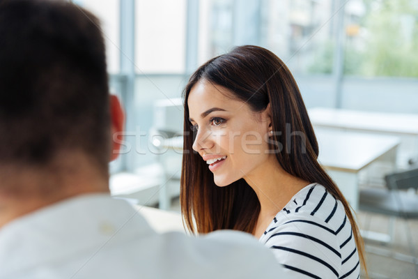 Stock photo: Businesswoman sitting and working with her colleague in office