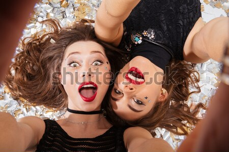 Dois sensual mulheres jovens gótico halloween make-up Foto stock © deandrobot