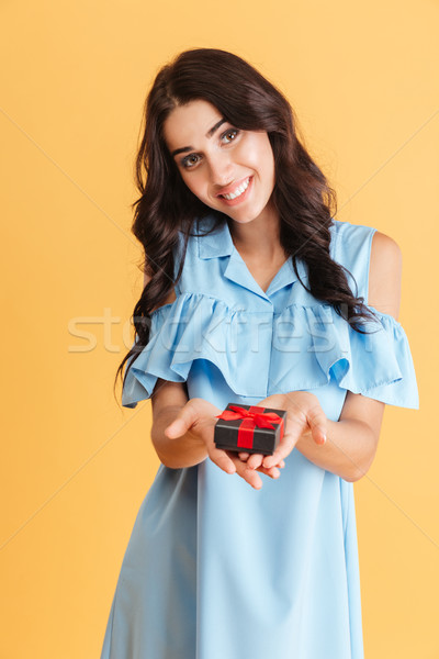 Smiling pretty woman in blue dress holding jewellery box Stock photo © deandrobot