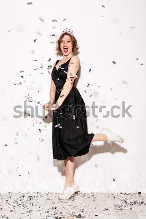 Woman in blade necklace holding cotton candy and old razor Stock photo © deandrobot