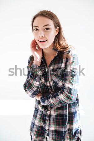 Happy young woman in plaid shirt standing with hands folded Stock photo © deandrobot
