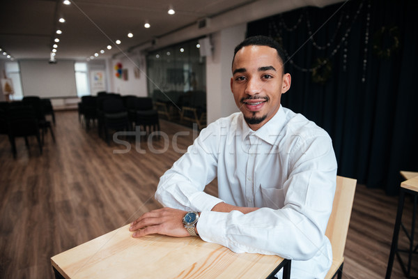 Cheerful african businessman coworking. Stock photo © deandrobot