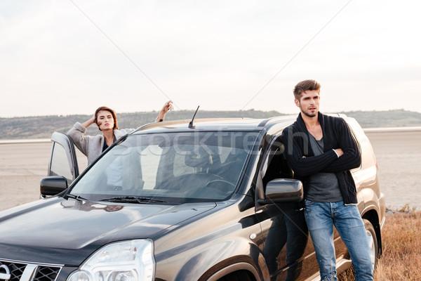 Em pé carro beira-mar jovem casual Foto stock © deandrobot